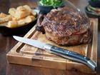 Feast on a delicious steak with fries and wine at The Ox Bristol.